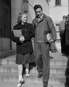 "Photo of Mr. and Mrs. Bartrum walking on campus on November 30, 1946. Photo was taken for C.S.C. Students and written in the 'name' field is ""Ed Servio""."